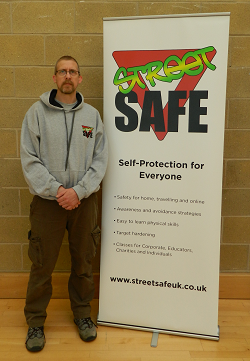 Andi Kidd next to the Street Safe banner